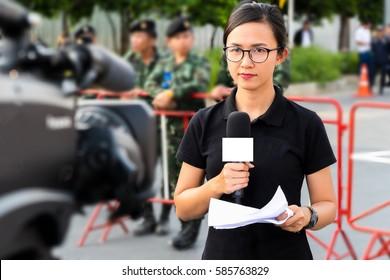 Female Journalist Outside Broadcasting in thailand.