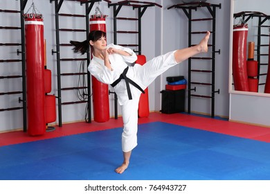Female karate instructor in dojo