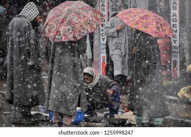 A Female Kashmiri Street Vendor Selling Fresh Fish during Heavy Snowfall In Qazigund Kashmir on 12 December 2018.