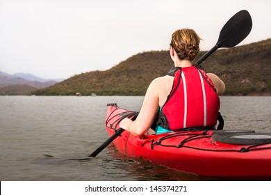 Female Kayaker on Desert Lake
