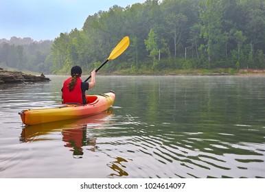 Female Kayaker on Lake