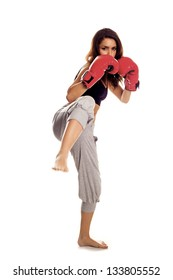 A female kick boxer wearing red gloves over a white background. Kickboxing woman.