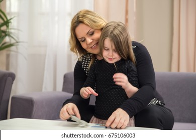 Female with kid is checking health issues like dyslexia and autism