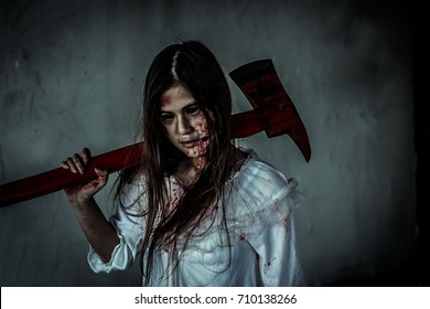 Female killer carrying an ax and his body was filled with blood.