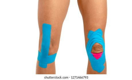Female knee with physio tape on white background