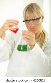 Female lab worker testing and experimenting