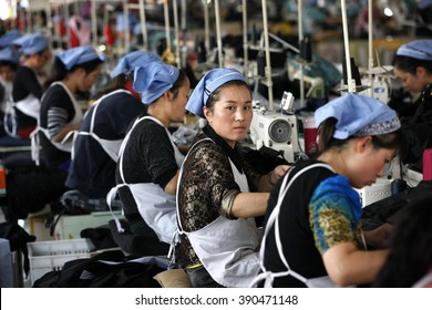 Female labors work in a cloth factory which export to European Union  in Huaibei, Anhui province, East China on 13th October 2015.