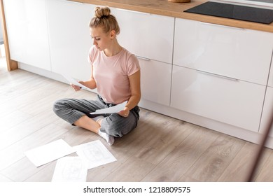 female lawer is working at home.problems with loan.side view full length photo