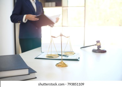 Female lawyer Legal counsel presents to the client a signed contract with gavel and legal law. justice and lawyer woman business  concept