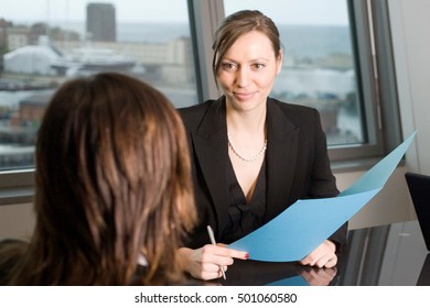 Female lawyer in a panorama office