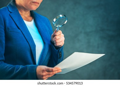 Female lawyer reading legal contract agreement disclaimer with magnifying glass, company's legal representative working