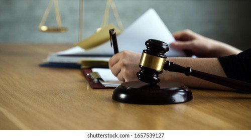 female lawyers working at the law firms. Judge gavel with scales of justice. Legal law, lawyer, advice and justice concept.