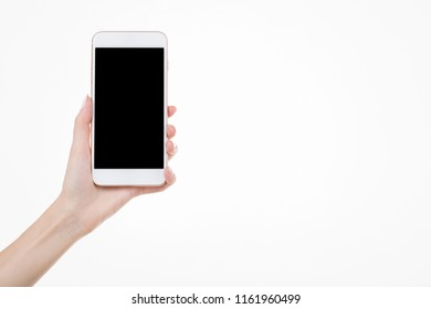 Female left hand holding smartphone with blank screen on white background