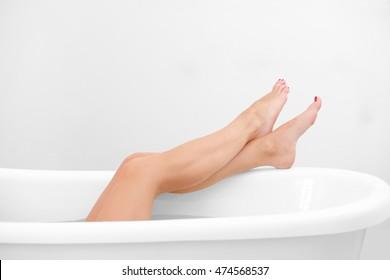 Female legs in bathtub