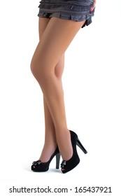 Female legs in black high heel shoes