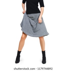Female legs in boots with lifted skirt, knitted clothes. Photo with clipping path.