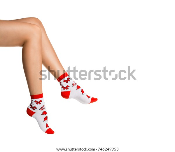 female legs in Christmas socks