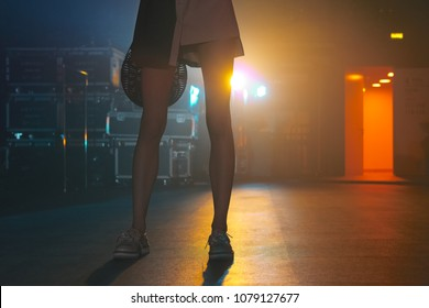 Female legs in darkness of backstage