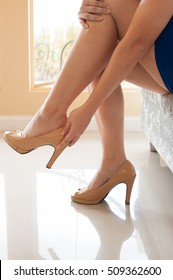 female legs in fashion shoes. isolated on high heel shoes while sitting on sofa at the shoe store.. Beautiful legs.