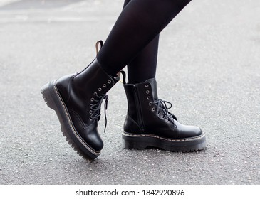 Female legs in fashion and stylish boots on grey street background - Shutterstock ID 1842920896