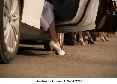 Female legs get out of the car