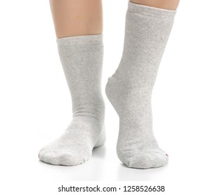 Female legs in gray socks on white background. Isolation