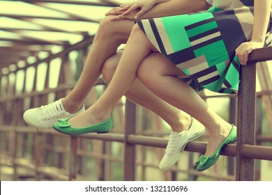Female legs and green shoes
