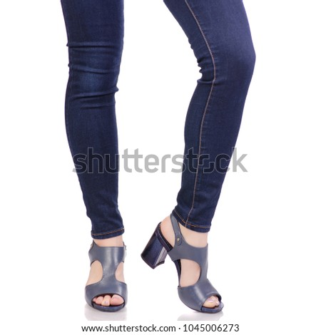 9d340c7cc Female legs in jeans and in blue sandals shoes fashion beauty shop buy on  white background isolation - Image