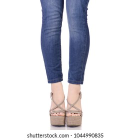 129a0b15e Female legs in jeans and gray sandals on a wedge buy shop fashion beauty on  a