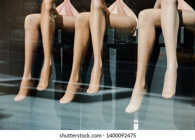 female legs mannequins in a shop window