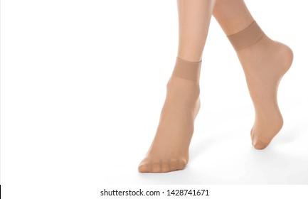 Female legs nylon pantyhose socks body pattern on white background isolation.