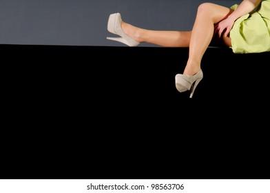 Female Legs on black background.