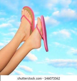Female legs in pink sandals. Summer concept.
