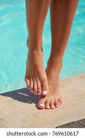Female legs at the pool. Female feet.
