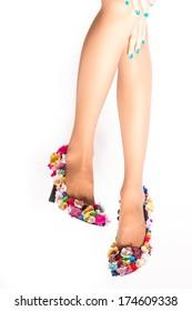 female legs wearing high heels on white background
