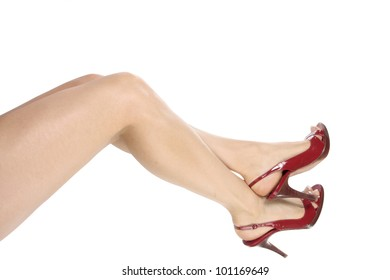 Female legs wearing red heel shoes over white background