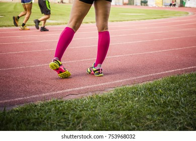 female legs wearing sport equipment during warming up