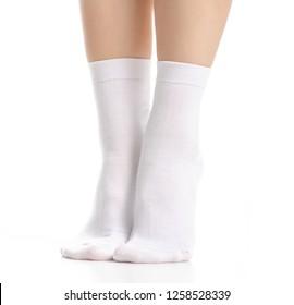 Female legs in white socks on white background. Isolation