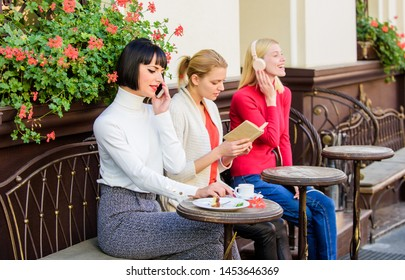 Female leisure. Weekend relax and leisure. Different interests. Hobby and leisure. Group pretty women cafe terrace entertain themselves with reading speaking and listening. Information source.