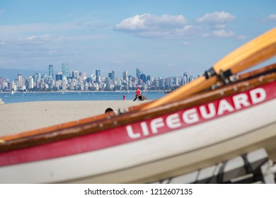 A female lifeguard watches over swimmers at Locarno beach, Vancouver. (face blurred out)