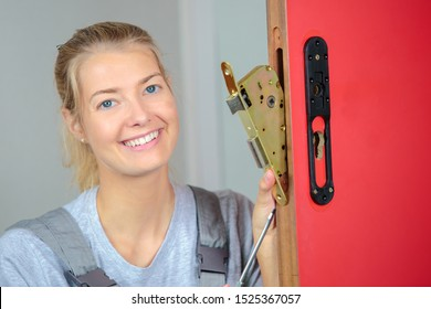 a female locksmith at work