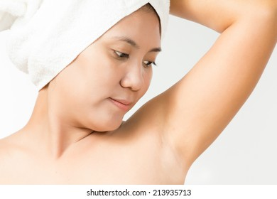 Female looking on her clean armpit