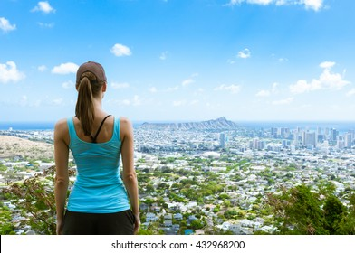 Female looking out at the city view. (Location Honolulu Hawaii)