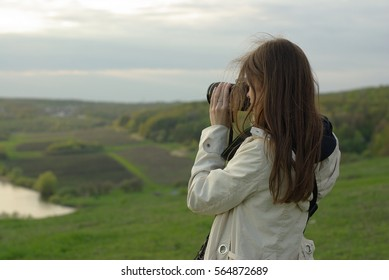 Female making a photo with professional camera