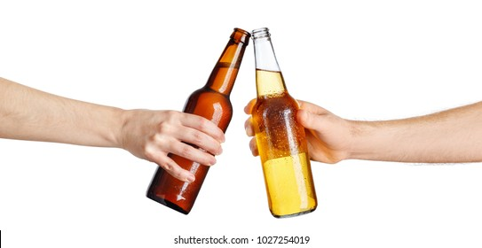 female and male hands with cold beer bottles making toast isolated on white background