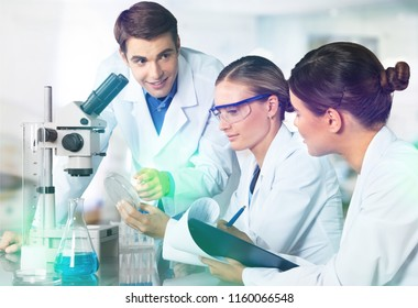 Female and male scientists working