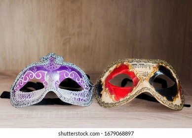 female and male venetian carnival masks isolated
