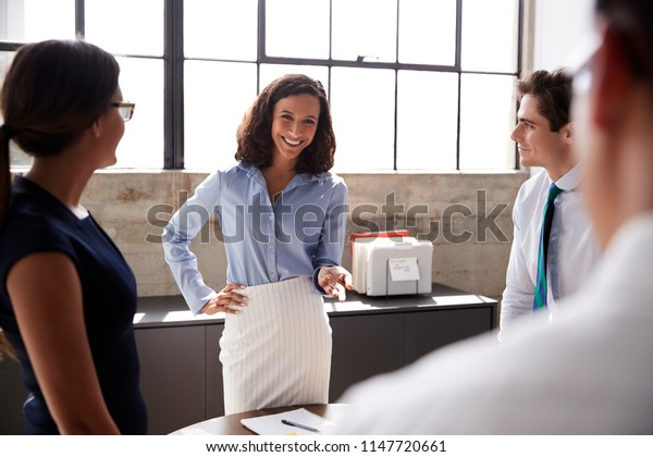 Female manager and business team in meeting, close up