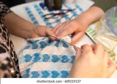 Female manicure on hands in a beauty salon