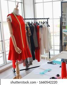 Female mannequin in a fashion shop, Working space of fashion designer, dressmaker or tailor. Dressmaking ,fashion design background.